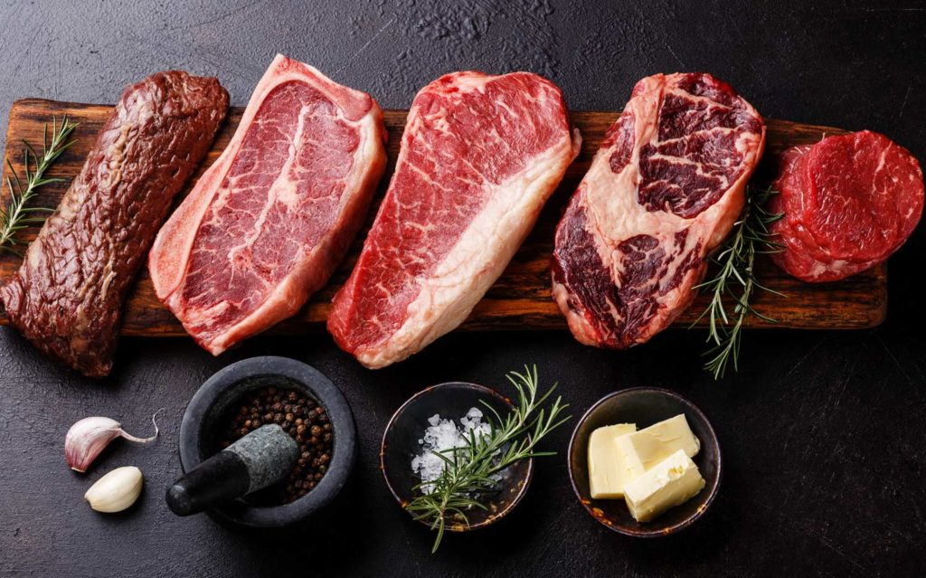 Image of 5 pieces of meat on table